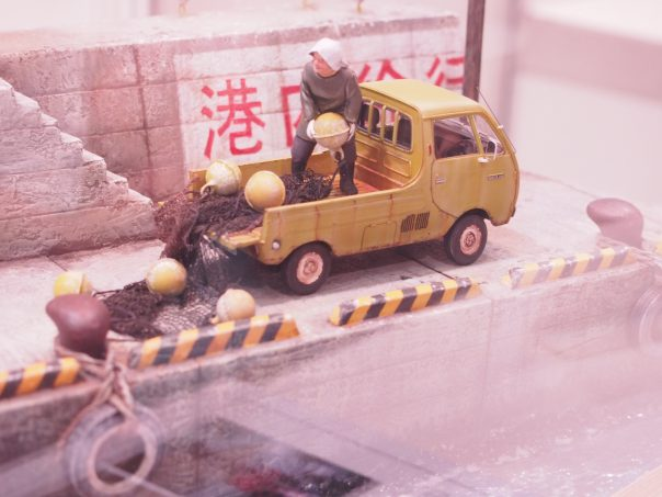 Diorama of Elederly lady is working at a wharf;