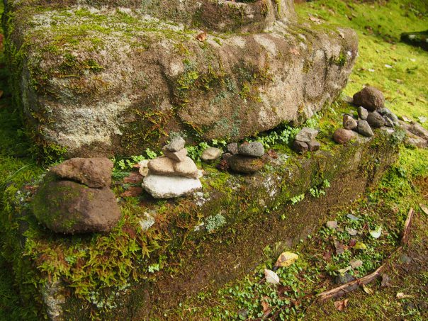 Stones Piled up in front of Jizo