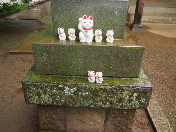 Cat Statues on Stone Lantern